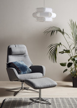 Design Project Rug No.090 £190, reclining chair No.122 £999, cushion No. 125 £55, pendant light no. 133 £80